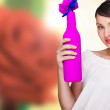 Portrait of young pretty woman holding bottle of prefect wine in — Stock Photo