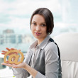 Portrait of a cheerful Business woman sitting on her desk holdin — Stock Photo