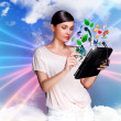 Young pretty woman using her universal device — Stock Photo