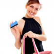 Portrait of a happy young woman woman with her handbag — Stockfoto