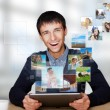 Portrait of young happy man sharing his photo and video files in — 图库照片