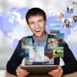 Portrait of young happy man sharing his photo and video files in — Stock Photo #8662813