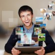 A technology man has images flying away from his modern tablet c — Stock Photo #8662822
