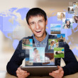 A technology man has images flying away from his modern tablet c — Stock Photo #8662885