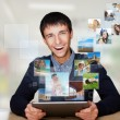 Portrait of young happy man sharing his photo and video files in — Stock Photo #8662902