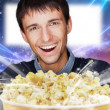 Portrait of young stylish modern man watching movie at modern ci - Stock Photo