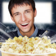 Portrait of young stylish modern man watching movie at modern ci — Stock Photo #8663212