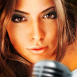 Trendy Singer Girl Singing In Retro Mic — Stock Photo #8663252