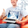 portrait of handsome young man holding laptop computer and worki — Stock Photo