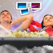 Stockfoto: Close up of a cute couple watching movie on their home cinema st