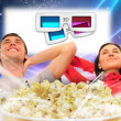 Close up of a cute couple watching movie on their home cinema st — Stockfoto