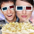Portrait of young stylish modern couple wearing 3d glasses watch — 图库照片