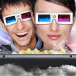 Stock Photo: Portrait of young stylish modern couple wearing 3d glasses watch