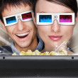 Portrait of young stylish modern couple wearing 3d glasses watch — Stock Photo #8663395