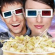 Portrait of young stylish modern couple wearing 3d glasses watch — Stock Photo