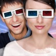 Portrait of young stylish modern couple wearing 3d glasses watch — Stock Photo #8663413