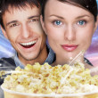 Portrait of young stylish modern couple watching movie against f — Stock Photo