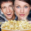 Portrait of young stylish modern couple watching movie at cinema — Stock Photo