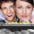Portrait of young stylish modern couple watching movie at home e — Foto Stock