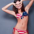20-25 years old beautiful woman in swimsuit with american flag a — Stock Photo #8663463