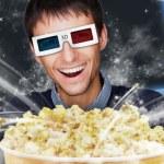 Portrait of young stylish modern man wearing 3d glasses watching — Stock Photo
