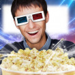 Portrait of young stylish modern man wearing 3d glasses watching — Stockfoto