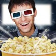 Portrait of young stylish modern man wearing 3d glasses watching — Stock Photo #8663594