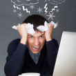 Closeup of a young angry business man having a stress. Headache. — Stock Photo