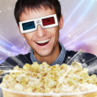 Portrait of young stylish modern man wearing 3d glasses watching — Stock Photo #8663631