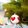 Christmas baubles against burning flame in fireplace on christma — Foto de Stock