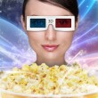 Portrait of young stylish modern woman wearing 3d glasses watchi - Stock Photo