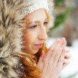 Portrait of pretty girl at winter background wearing warm clothe — Stock Photo #8663716