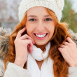 Portrait of beautiful young red hair woman outdoors in winter lo — Stock Photo #8663717