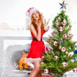 Christmas woman near a Christmas tree posing. Full length portra — Stock Photo