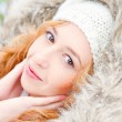 Portrait of pretty girl at winter background wearing warm clothe — Stock Photo #8663741