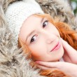 Portrait of pretty girl at winter background wearing warm clothe — Stock Photo #8663745