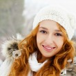 Stock Photo: Portrait of young pretty woman in winter park