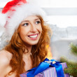 Royalty-Free Stock Photo: Christmas woman near a Christmas tree holding big gift box while