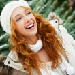 Portrait of young pretty woman in winter park — Stok fotoğraf