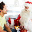 Two adult men - old father wearing Santa Claus suit — Stock Photo