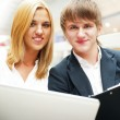Two students working on their college project at hall using lapt — Stock Photo