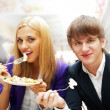 Closeup portrait of an attractive young couple eating fruit sala — Stock Photo