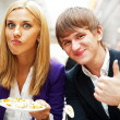 Closeup portrait of an attractive young couple eating fruit sala — Stock Photo #8663974