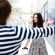 Young man meeting his girlfriend with opened arms at airport arr — Stok fotoğraf