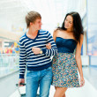 Portrait of young couple walking together at airport hall with t — Stok fotoğraf