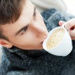 Portrait of a young man drinking coffee — Stock Photo #8664107
