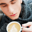 Portrait of a young man drinking coffee — Stock Photo #8664114