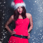 Retrato de joven Navidad hermosa posando usando santa — Foto de Stock   #8664115