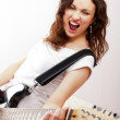 Portrait of beautiful young and attractive womanplaying her guit — Stock Photo