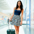 Young woman with luggage at the international airport. — Stock Photo